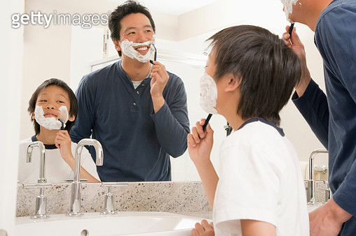 Asian father and son shaving in bathroom at home - gettyimageskorea