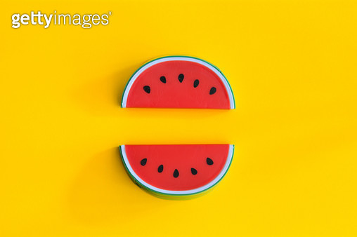 Close-Up Of Watermelon Toy Over Yellow Background - gettyimageskorea