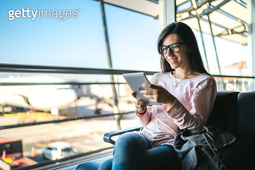 Woman at the airport - gettyimageskorea