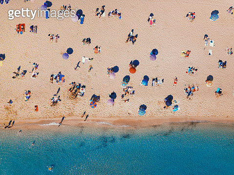 Aerial top view of people sitting on a sandy beach - gettyimageskorea