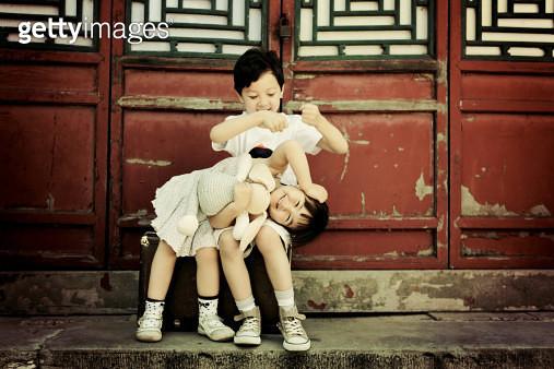 Sitting boy and girl - gettyimageskorea