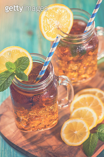 Ice Tea with Lemon and Mint in a Jar - gettyimageskorea