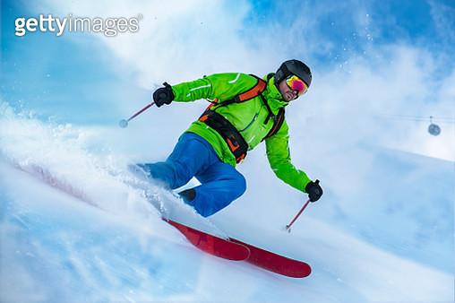 Low Angle View Of Man Skiing On Ski Slope - gettyimageskorea