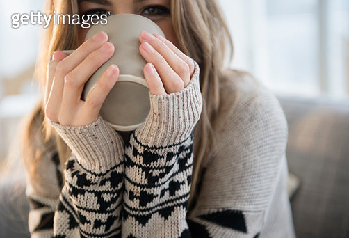 Young woman with mug - gettyimageskorea