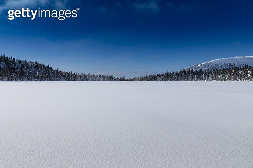 Scenic View Of Snowcapped Landscape Against Blue Sky - gettyimageskorea