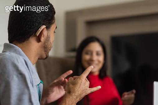 Deaf talking in sign language - gettyimageskorea