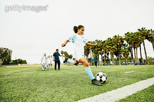 Young female soccer player taking warm up shot before game - gettyimageskorea