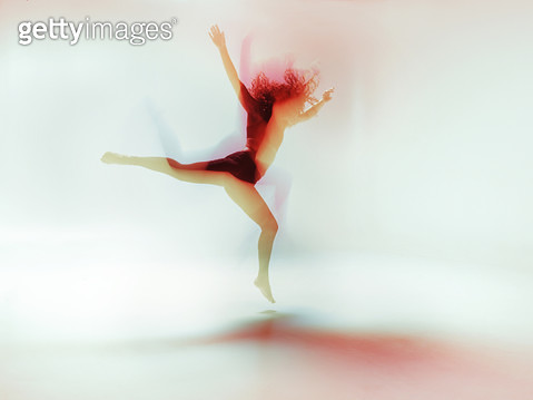 Female dancer moving gracefully and powerful in a bright colorfull room, long time exposure - gettyimageskorea