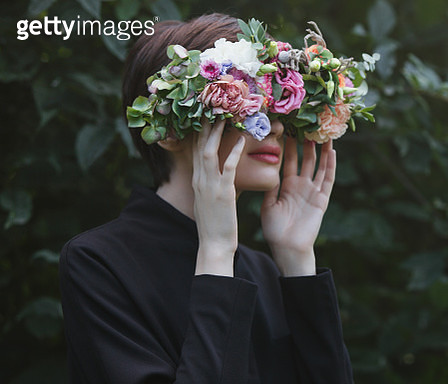 Woman wearing glasses covered by real flowers - gettyimageskorea