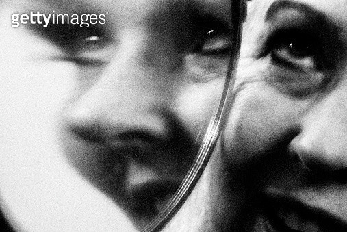 Surrealistic Woman's Face Reflected in Mirror - gettyimageskorea