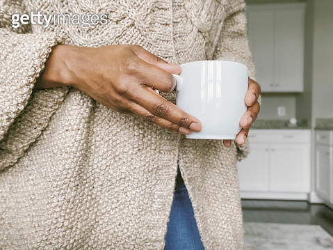 Midsection of Woman Holding Coffee Cup - gettyimageskorea