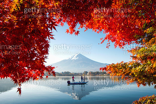 Fuji Mountain Reflection and Red Maple Leaves with Fisherman Boat in Autumn, Japan - gettyimageskorea