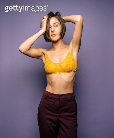 Beautiful young woman in yellow top and purple pants - gettyimageskorea