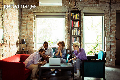 Close up of a group of designers coming up with ideas while relaxing on a sofa - gettyimageskorea