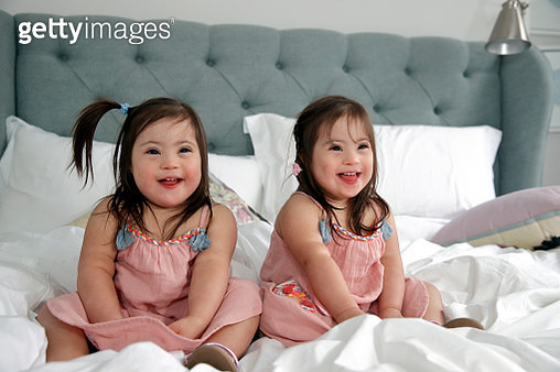 Happy toddlers with Down Syndrome, happy, cute, pigtails - gettyimageskorea
