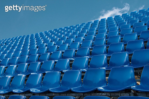 Low Angle View Of Empty Blue Chairs Against Sky - gettyimageskorea