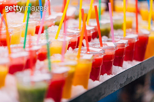 Fresh fruit juice on the market stall in the Mercado Central (Central Market), Valencia, Spain - gettyimageskorea