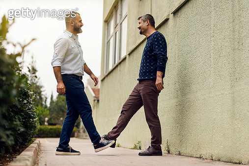 """COVID-19 """"Foot to foot"""" Greeting Concept. """"Foot shake"""" a new way of greeting that avoid handshake to stop the spread of the coronavirus. - gettyimageskorea"""