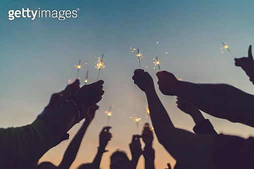 Friends celebrating New Year on the rooftop - gettyimageskorea