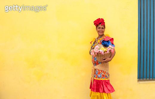 Cuban woman in colourful dress - gettyimageskorea