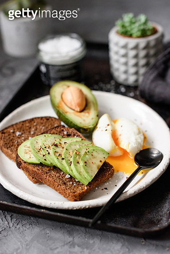 Avocado rye toast with poached egg - gettyimageskorea