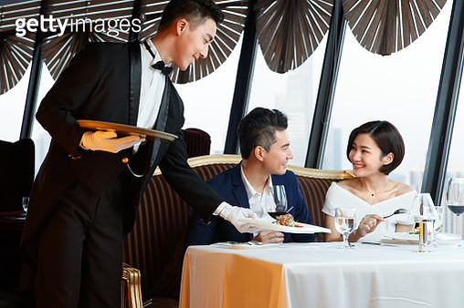 The hotel waiter serving for the customer - gettyimageskorea