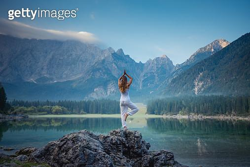 Beautiful woman doing yoga outdoor - gettyimageskorea