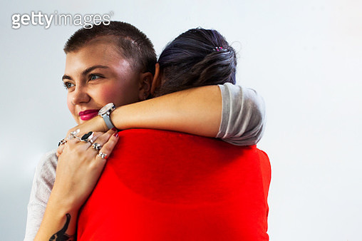 A young woman hugging - gettyimageskorea