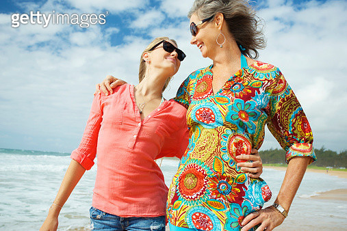 A mother and daughter together on the beach - gettyimageskorea