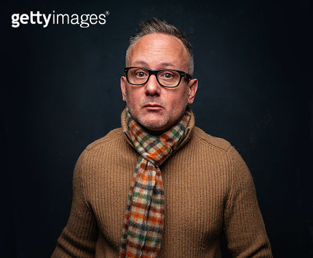 Middle-aged man wearing sweater and scarf - gettyimageskorea