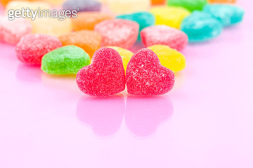 Close-Up Of Colorful Candies Against Pink Background - gettyimageskorea