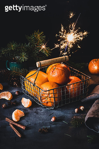 Orange mandarins with a Sparkler. Christmas food still life - gettyimageskorea
