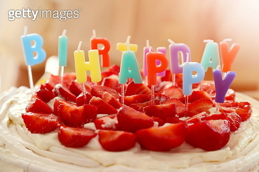 Close-Up Of Candles And Strawberries On Birthday Cake - gettyimageskorea