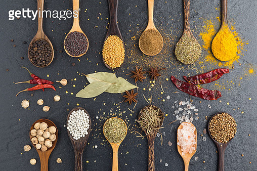 Close-Up Of Various Spices In Wooden Spoons On Table - gettyimageskorea