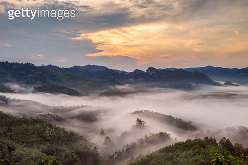 Layer Of Mountains In The Mist At Sunrise Timeedit Warm Tone - gettyimageskorea