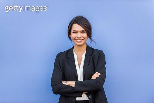 View of standing businesswoman - gettyimageskorea