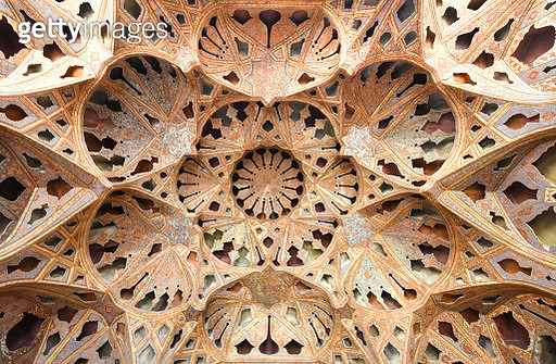"""Amazingly decorated kaleidoscope-like ceiling in Ali Qapu's palace (""""Kakh-e Ali Qapu"""") with colorful muqarnas in Isfahan, Iran, a UNESCO heritage site - gettyimageskorea"""