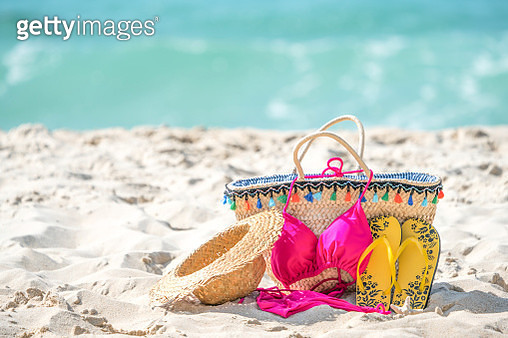Straw hats, sunglasses bags and sandals and bikinis on tropical beaches. - gettyimageskorea