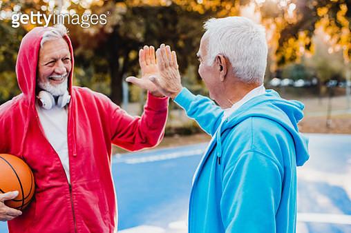 Two senior men celebrating with high five gesture - gettyimageskorea