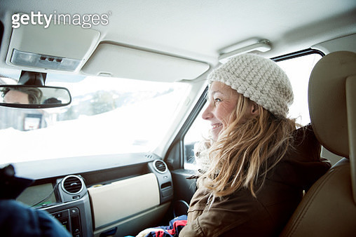 young woman in car, winter holiday - gettyimageskorea