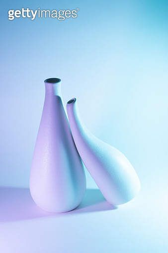 Two Vases with Purple and Blue Gradient Colored Light Effect. Romance Concept. - gettyimageskorea