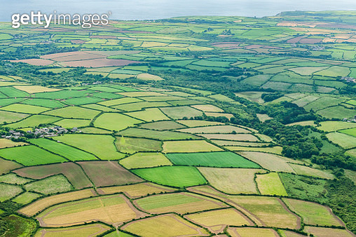 Aerial views of Patchwork rural fields near Penzance, Cornwall on a sunny June day. - gettyimageskorea