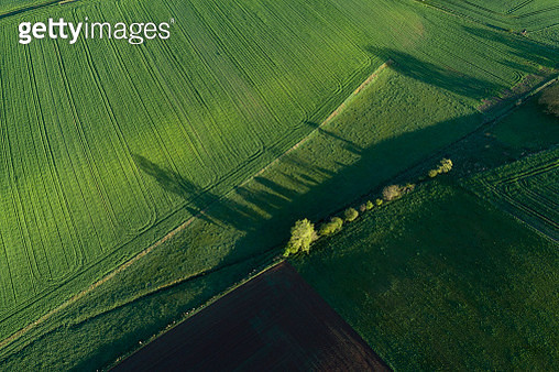 Aerial View of abstract landscape with agricultural fields, trees and meadow at springtime. Franconia, Bavaria, Germany. - gettyimageskorea