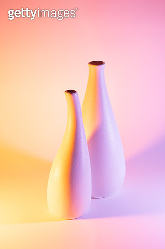 Two Vases with Orange and Pink Gradient Colored Light Effect. - gettyimageskorea