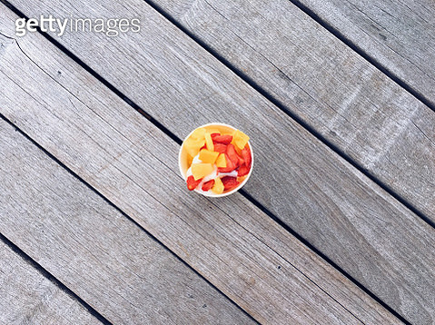 Frozen yoghurt with fresh fruits, directly above view - gettyimageskorea