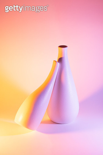 Two Vases with Orange and Pink Gradient Colored Light Effect.Romance Concept. - gettyimageskorea