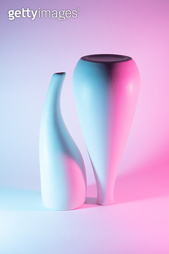 Two Vases with Pink and Blue Gradient Colored Light Effect. - gettyimageskorea
