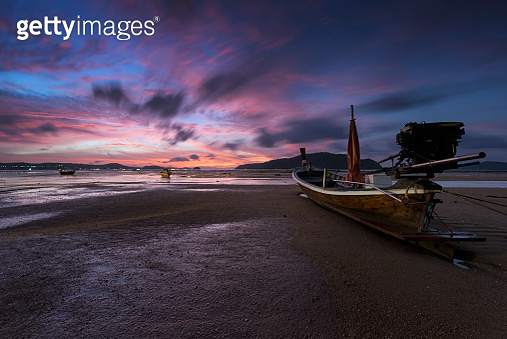 Long tail boat at sunrise with Low tide beach, Phuket, Thailand. - gettyimageskorea