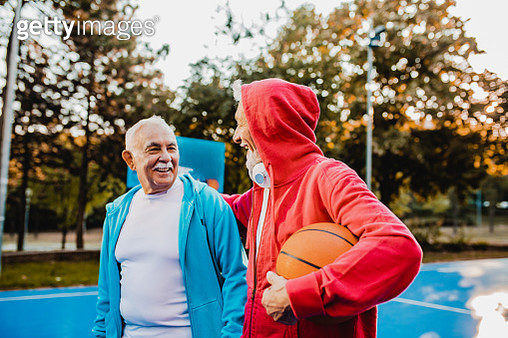 Two active senior men on basketball field - gettyimageskorea