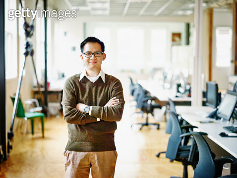 Smiling professional in high tech office - gettyimageskorea